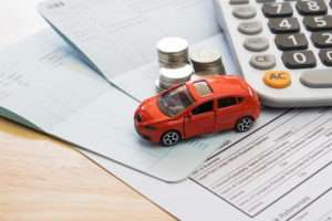 car and money on papers