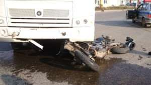 motorcycle crushed by bus