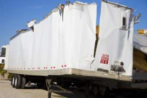 white truck with ripped top